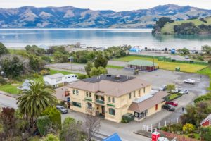 Akaroa tourism stalwart to check out of sector
