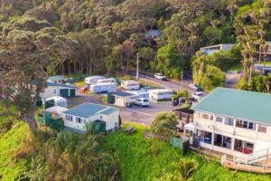Muriwai coastal lodge and campground complex for sale